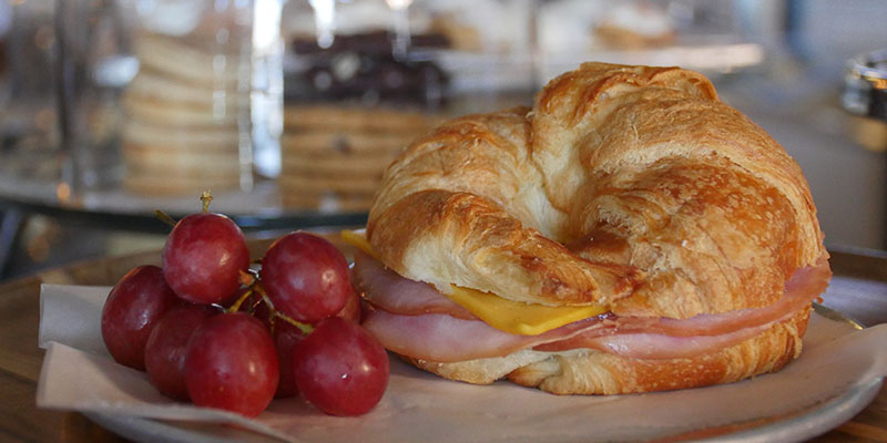 Ham and cheese croissant with grapes